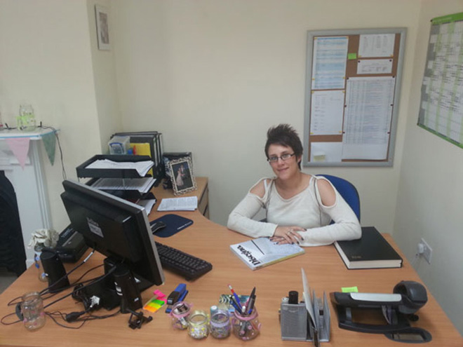 Stacey at her desk